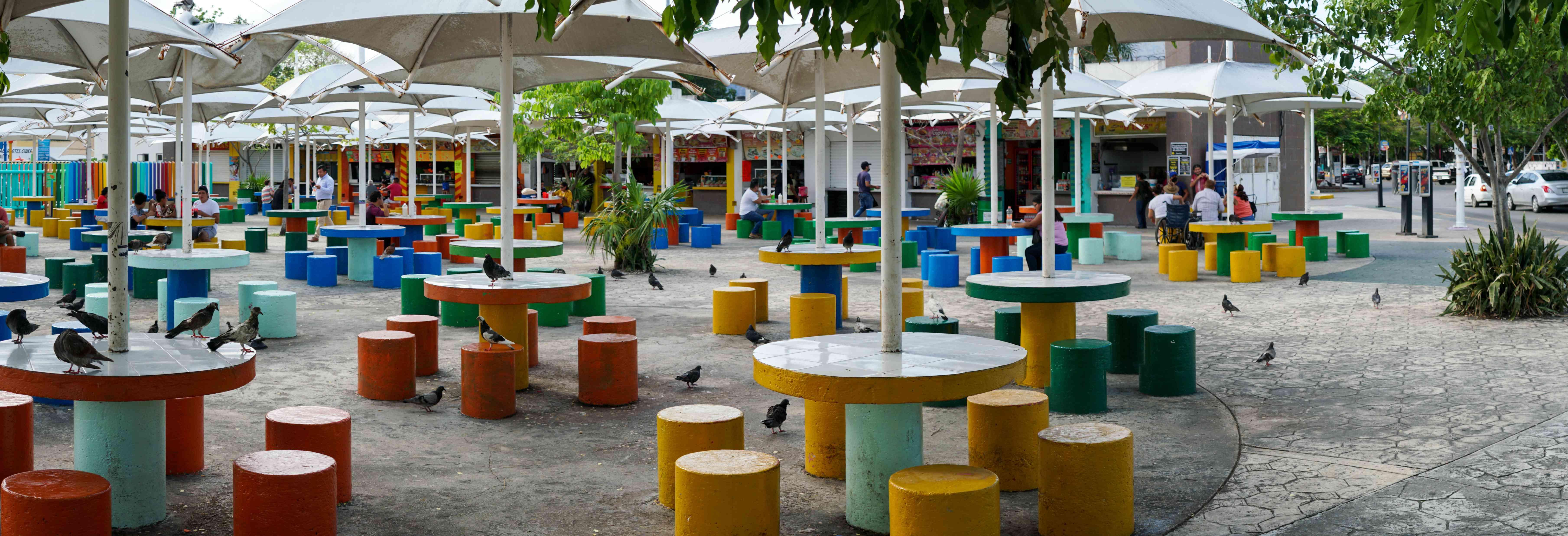 Empty colorful tables in Parque Las Palapas