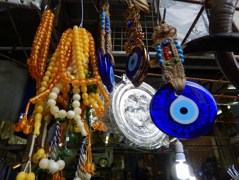 Good luck charms, protection against the evil eye and prayer beads at Shuk HaCarmel, Tel Aviv