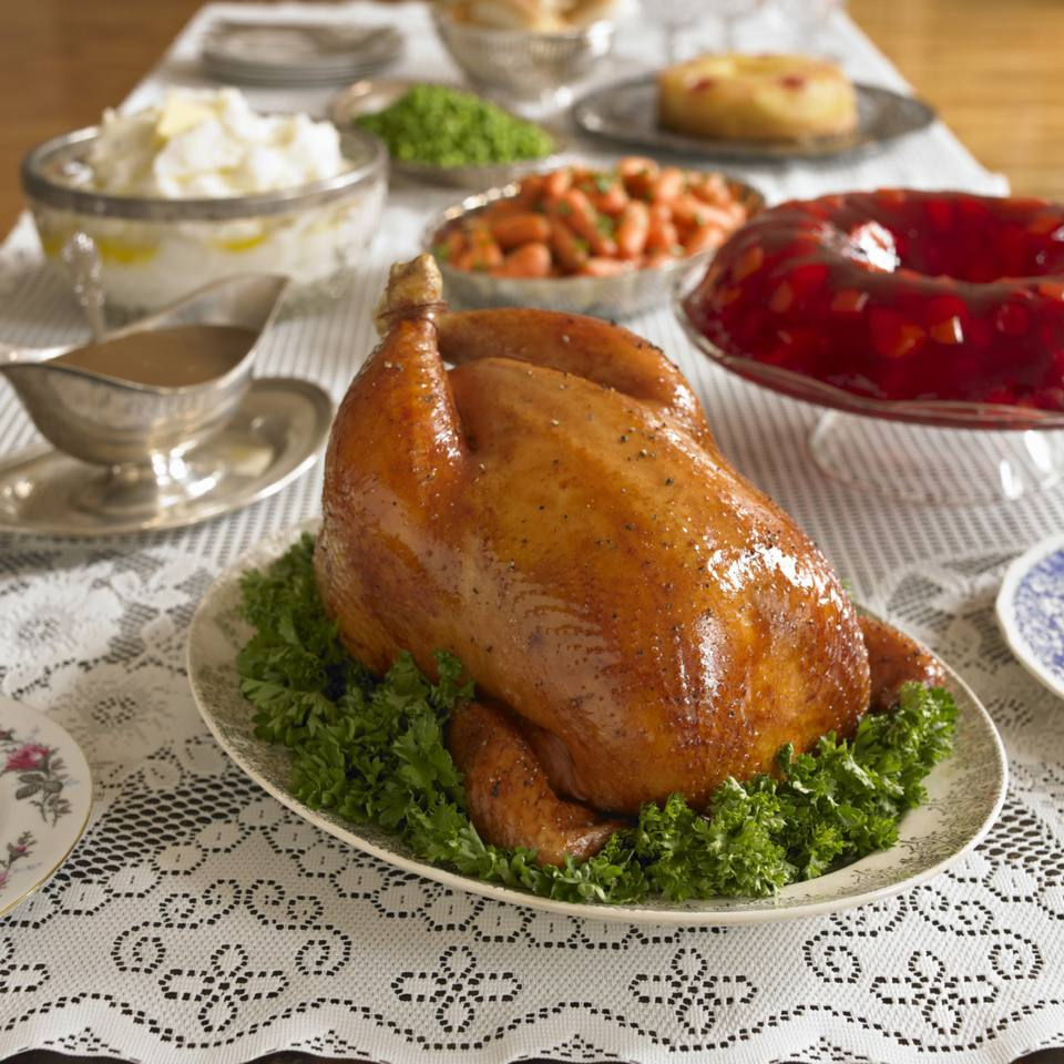 Thanksgiving turkey with all the right side dishes.
