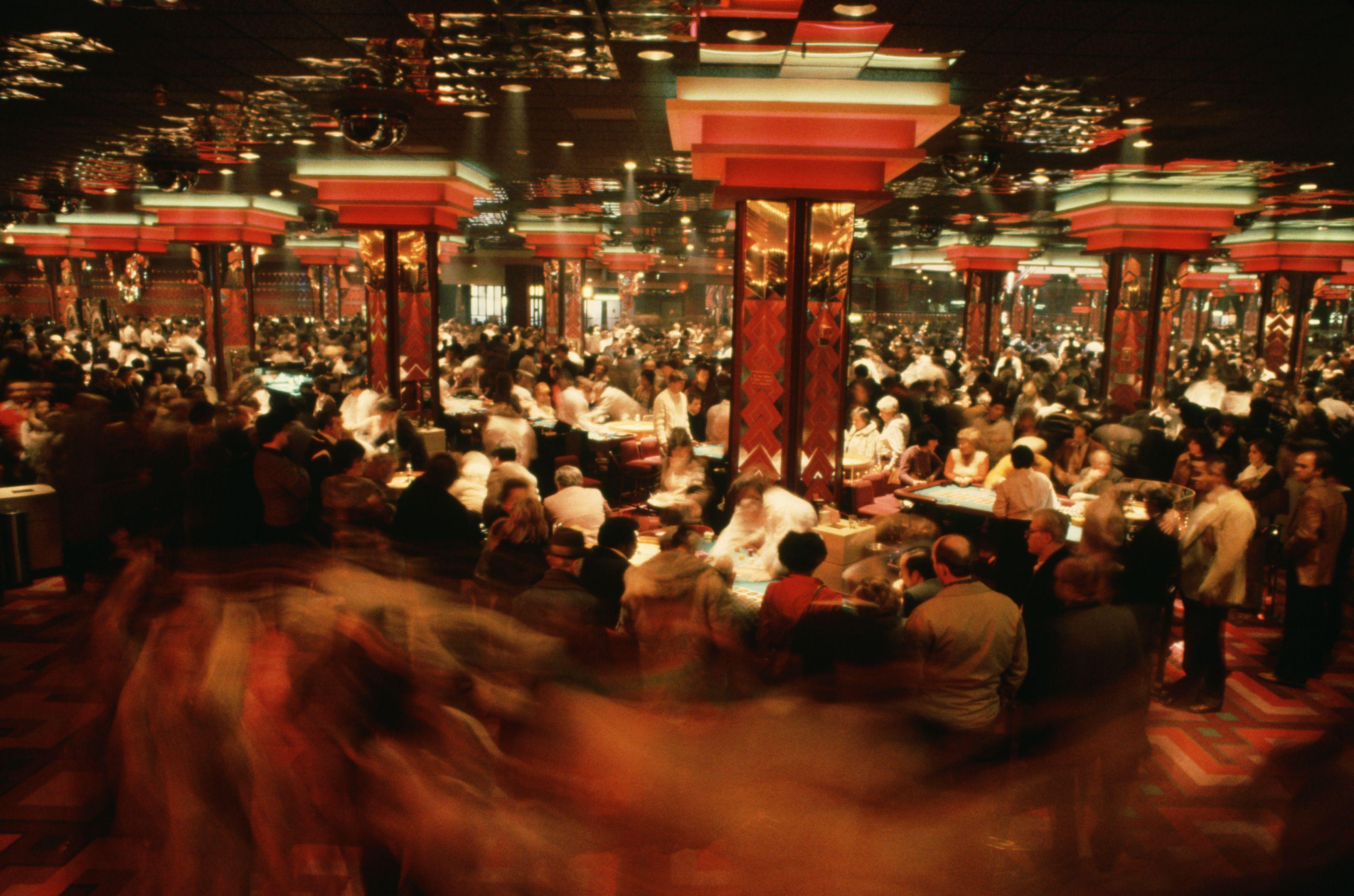 Hundreds of gamblers play roulette and other games on the floor of Caesars Casino in Atlantic City, New Jersey.   Location: Caesars Casino, Atlantic City, New Jersey, USA.