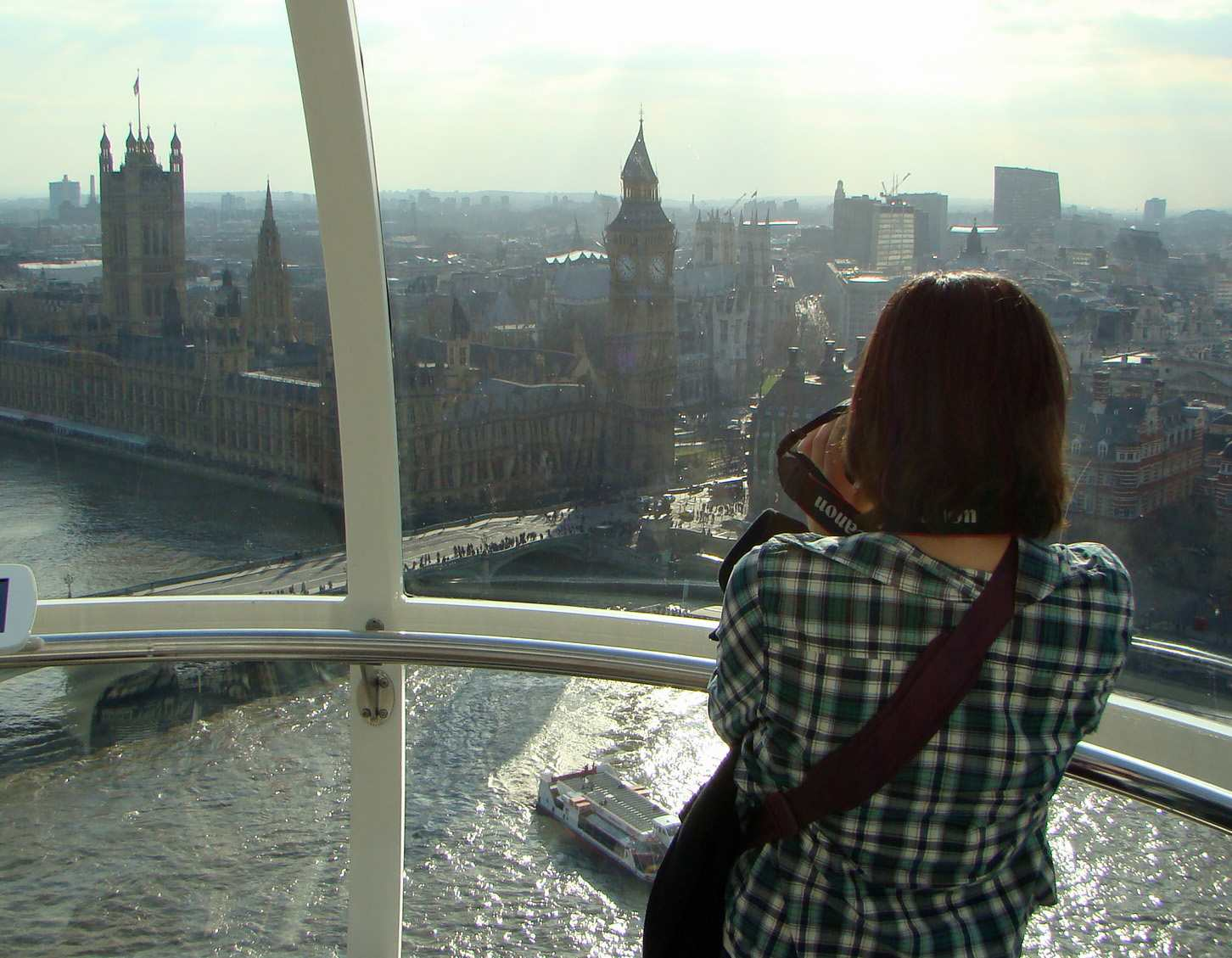A woman taking a picture of the view