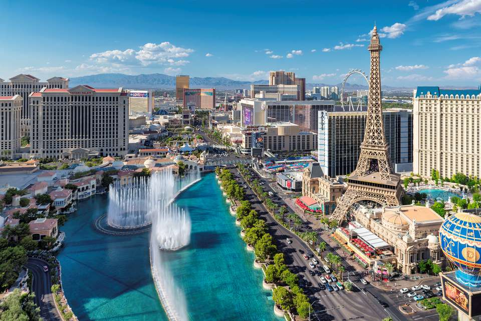Aerial view of Las Vegas strip featuring the fountains of the Bellagio Casino and the Eiffel Tower