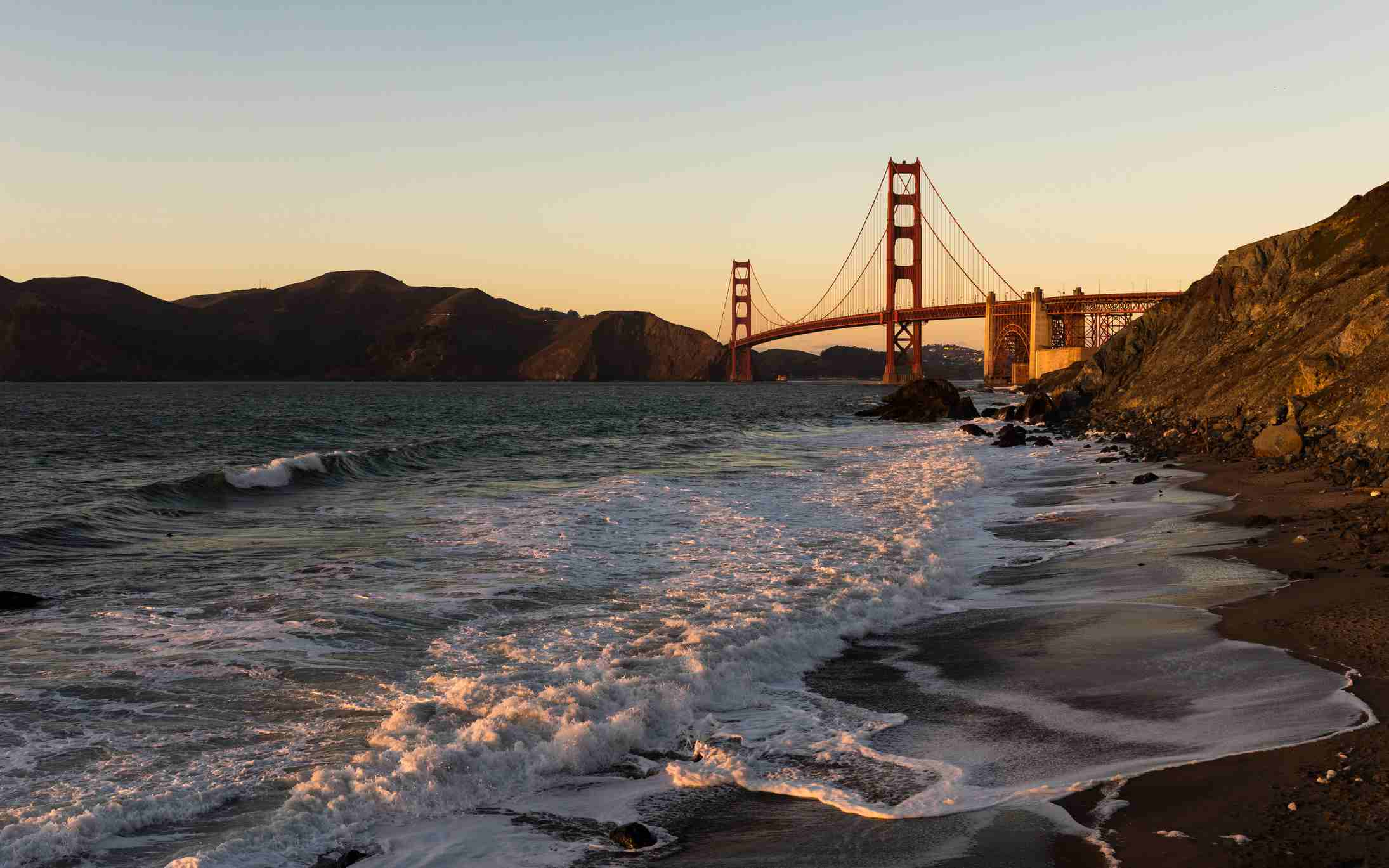 San Francisco's Marshall Beach, near Golden Gate overlook, located at the base of the Golden Gate Bridge at sunset