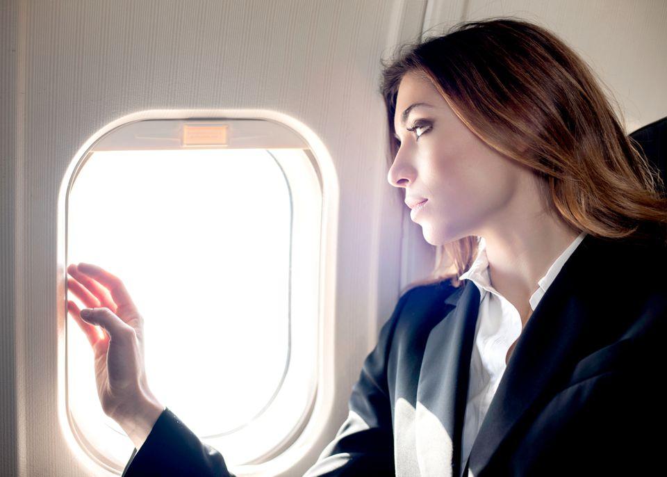 Sad woman in airplane seat