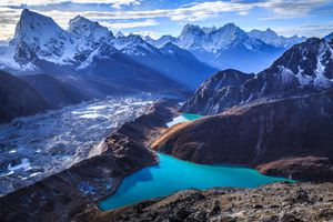 blue lake surrounded by snow-capped mountains