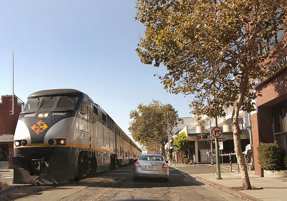 Amtrak train in the Jack London Sq district of Oakland California