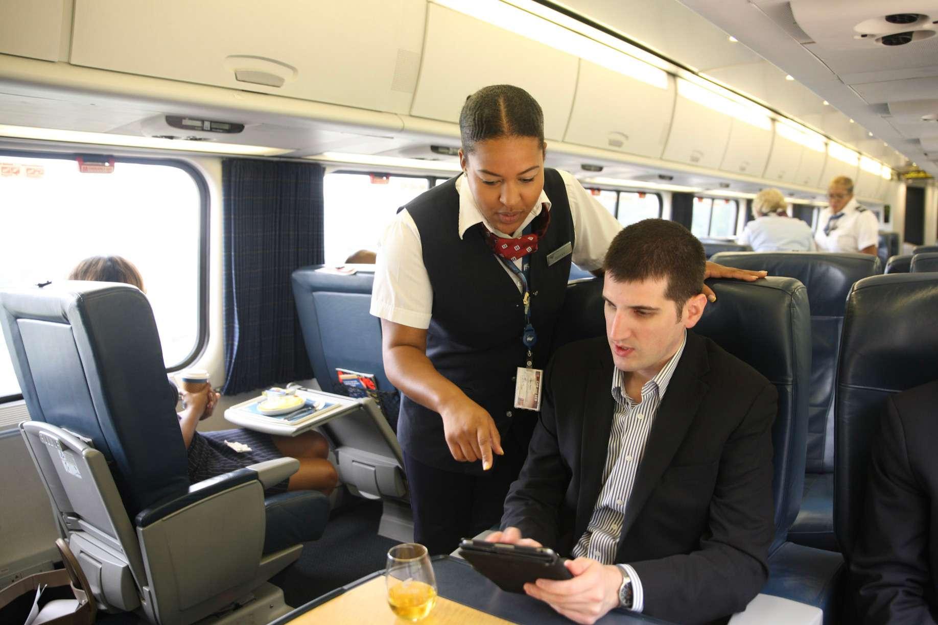 Amtrak employee assisting rider