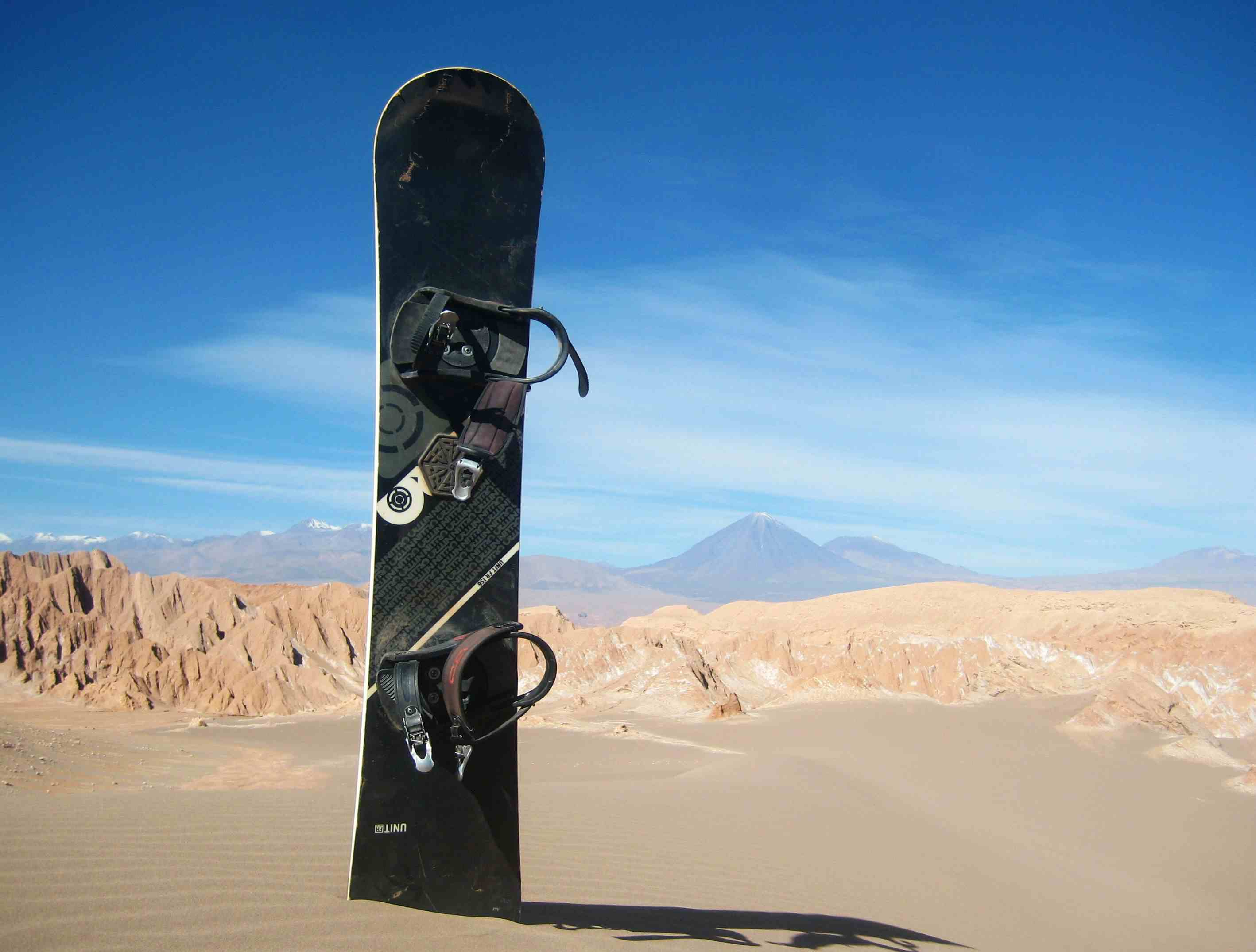 Snowboard sticking out of the sand in the Atacama Desert