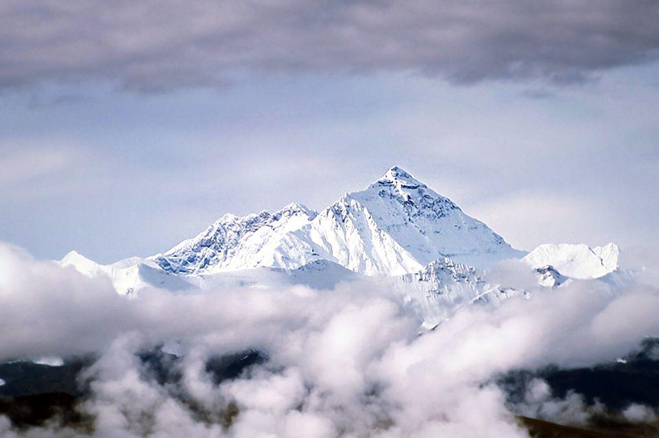 Peak of Mount Everest above clouds in Tibet