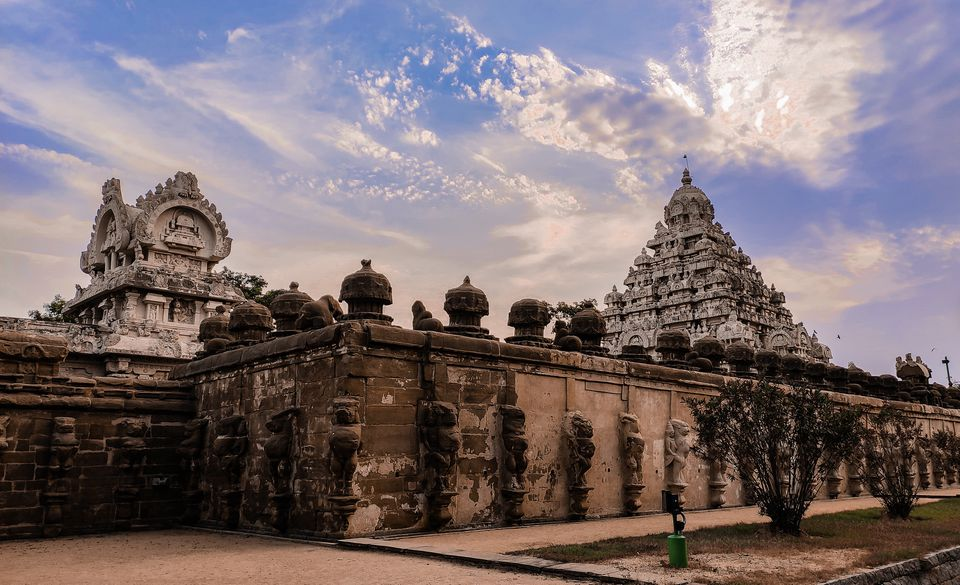 Kanchipuram temples seen above a stone wall on a sunny day