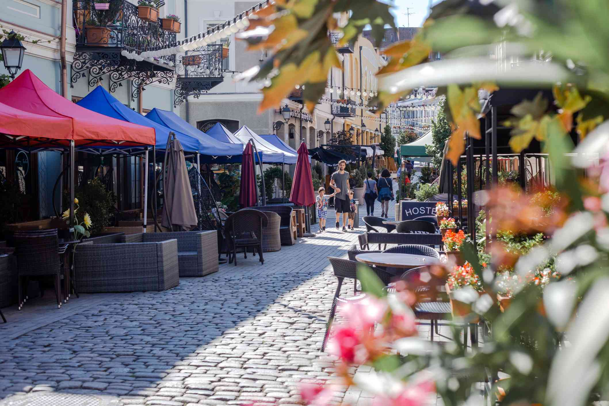 A cobble stone street in Tbilisi lined with wine cafes
