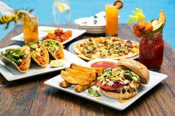 A full table of vegan food from VegeNation