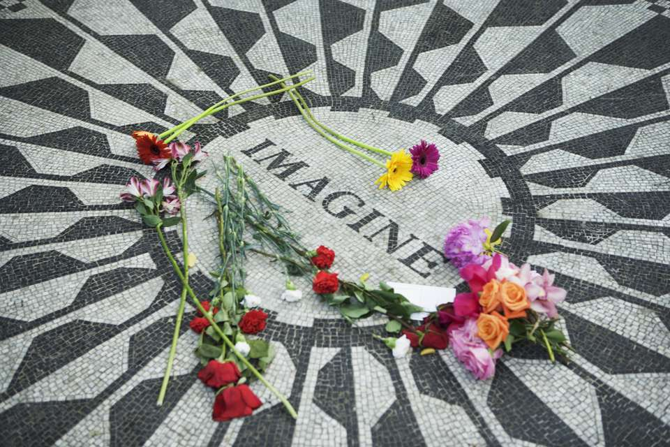 Strawberry Fields Memorial to John Lennon in Central Park with flowers on it