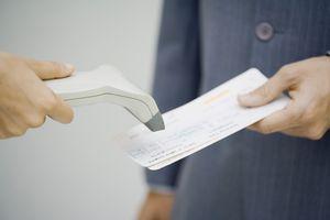 Passenger having their boarding pass scanned