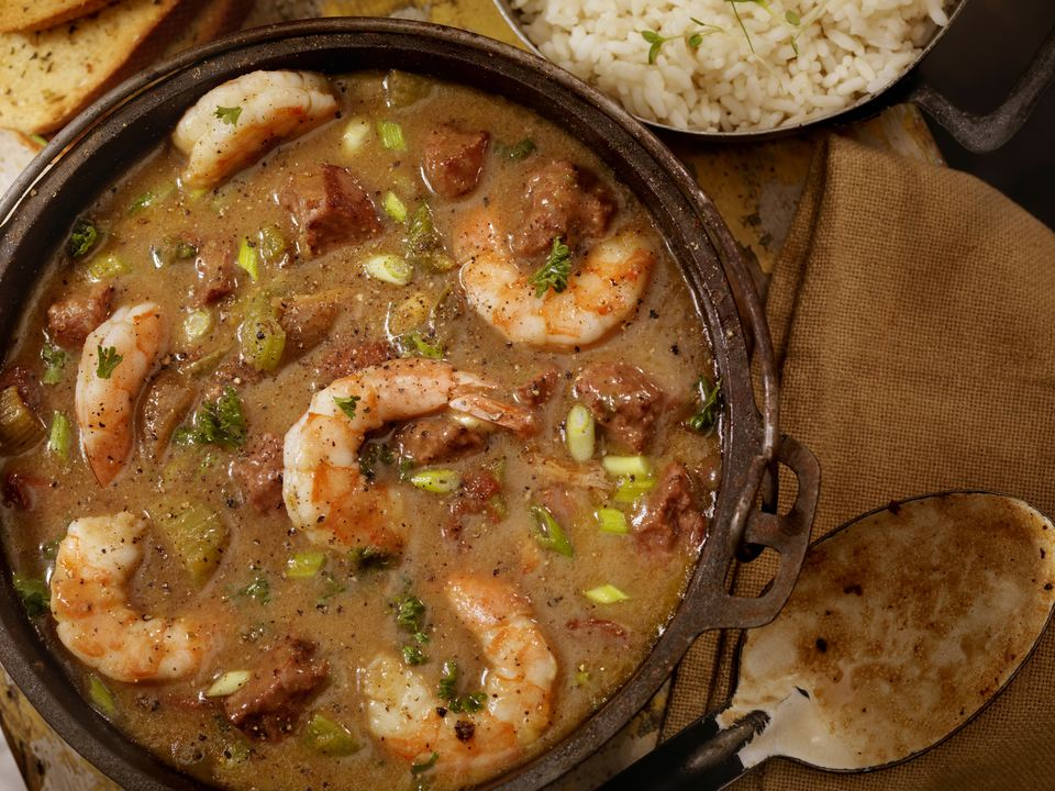 Creole Style Shrimp And Sausage Gumbo In A Cast Iron Pot With White Rice French
