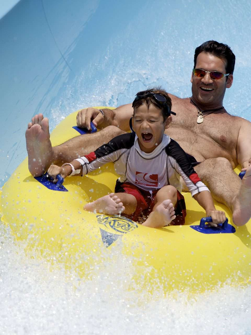 Man and son on water slide at LanierWorld