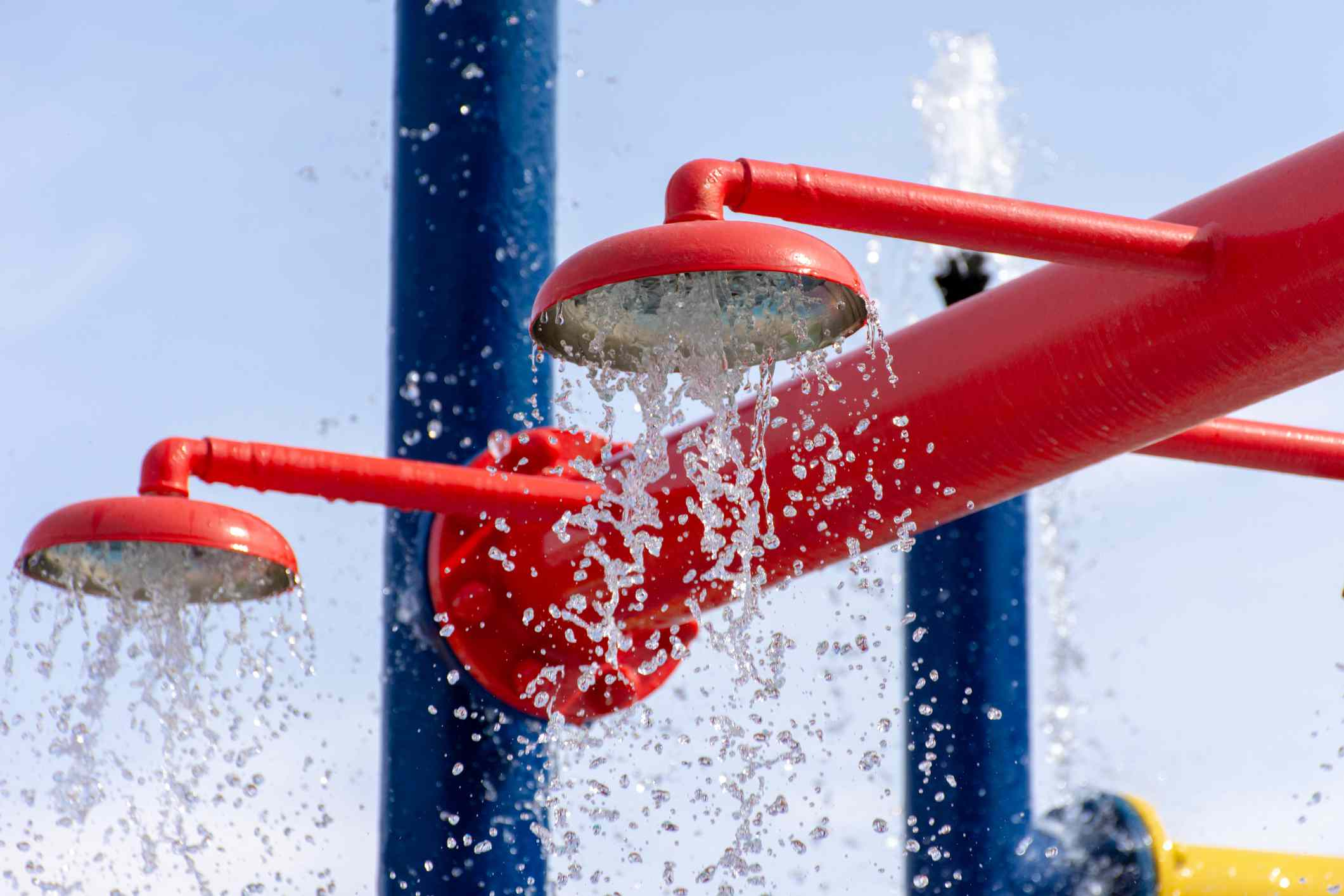 Summertime fun for the kids at the splash pad to play with water falling from bright colored fountains.