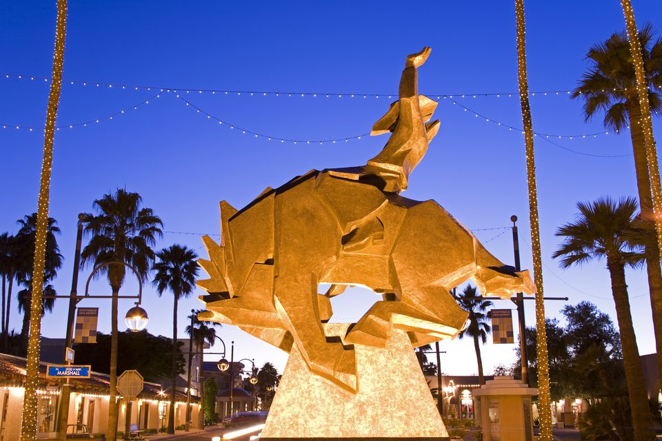 Sculpture of cowboy on bucking horse in Old Scottsdale