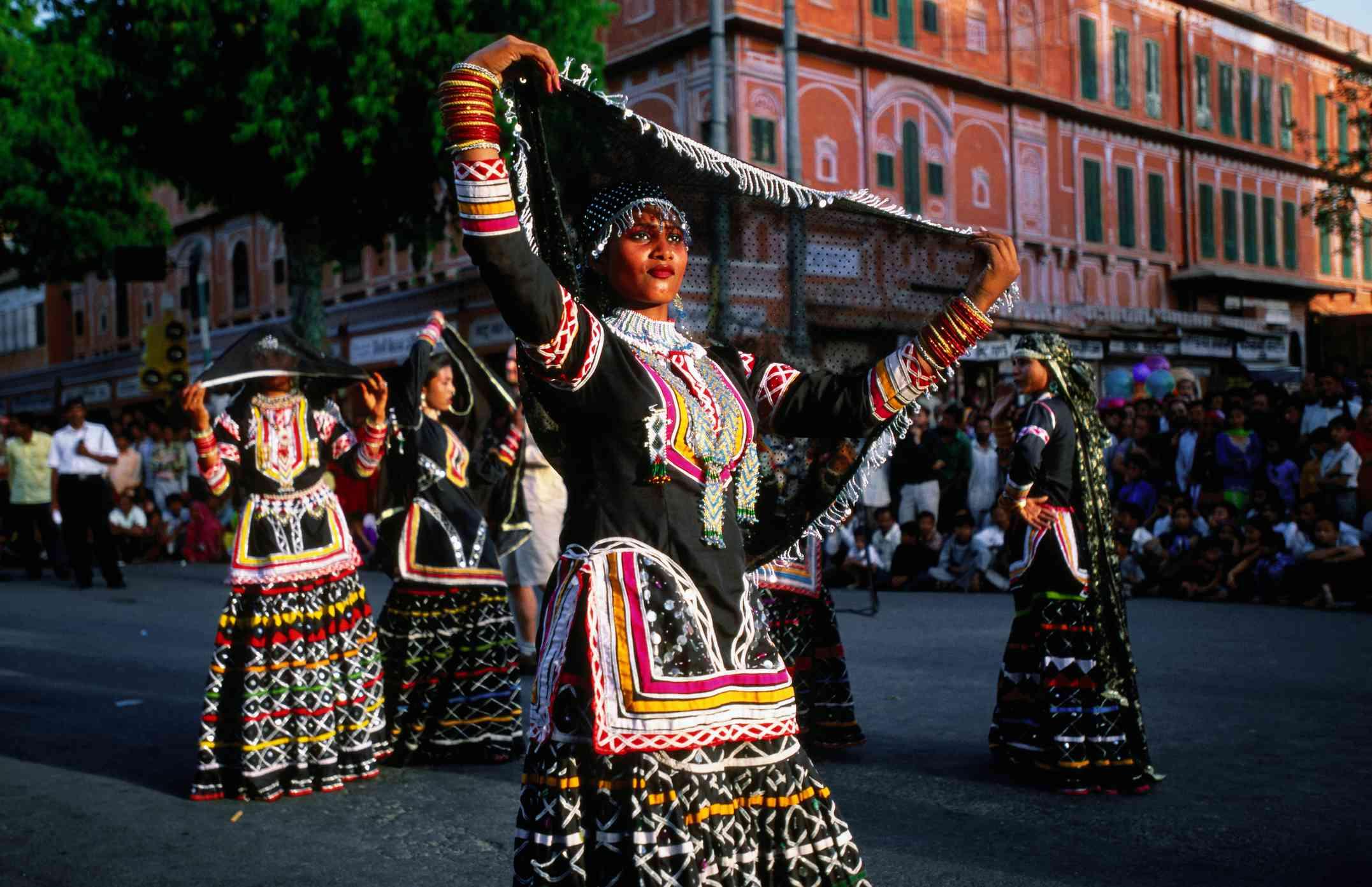 Female dancers from Bhil tribe at Gangaur Festival street parade.