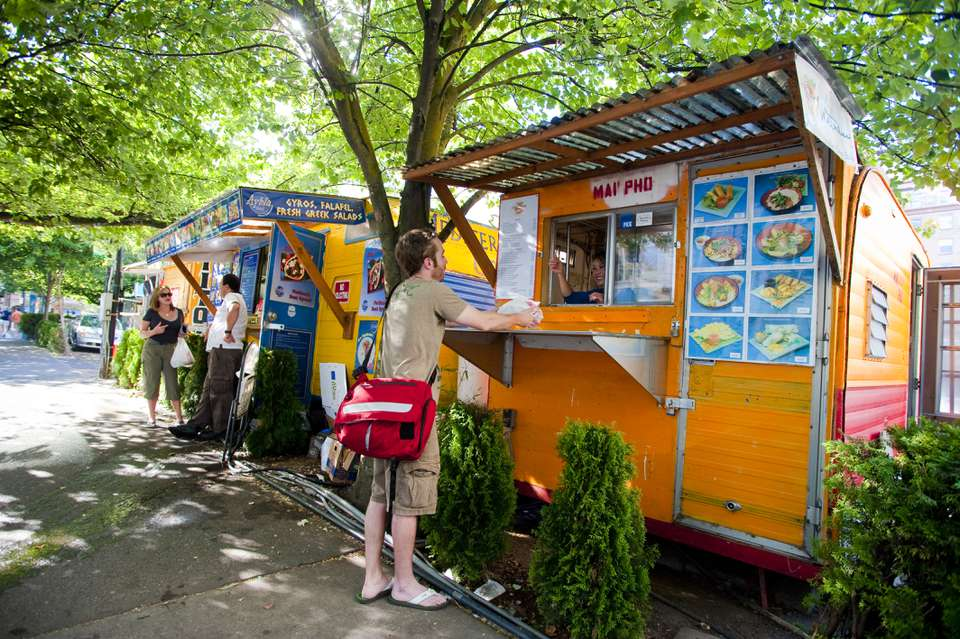 Customers at food carts at the SW 9th & Alder Food Cart Pod, downtown