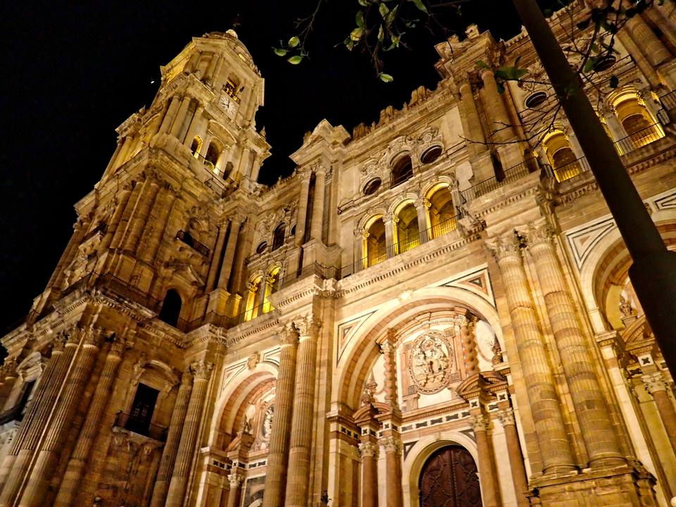 malaga cathedral lit up at nighttime