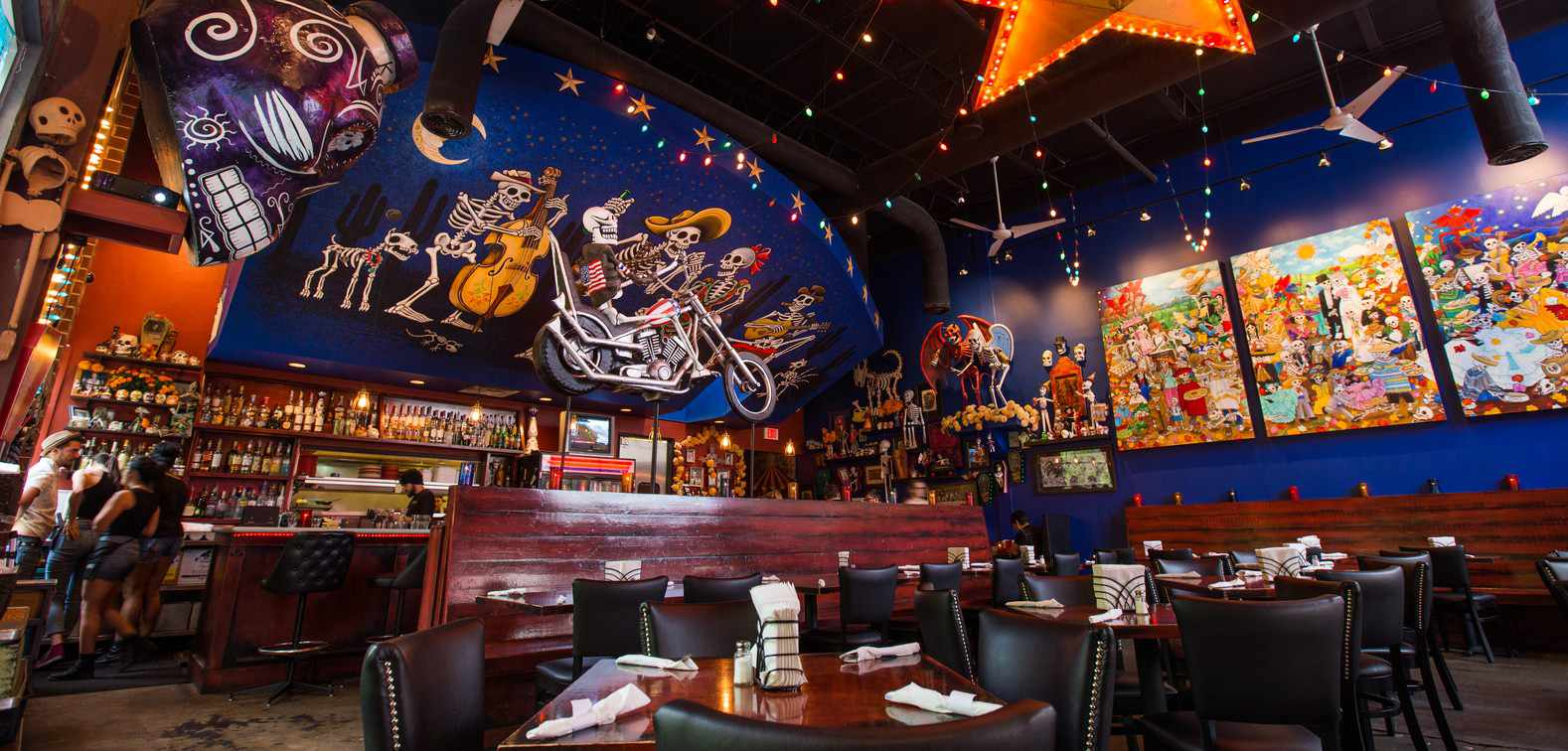 Interior of Bone garden cantina with dia de los muertos murals and paintings on the walls