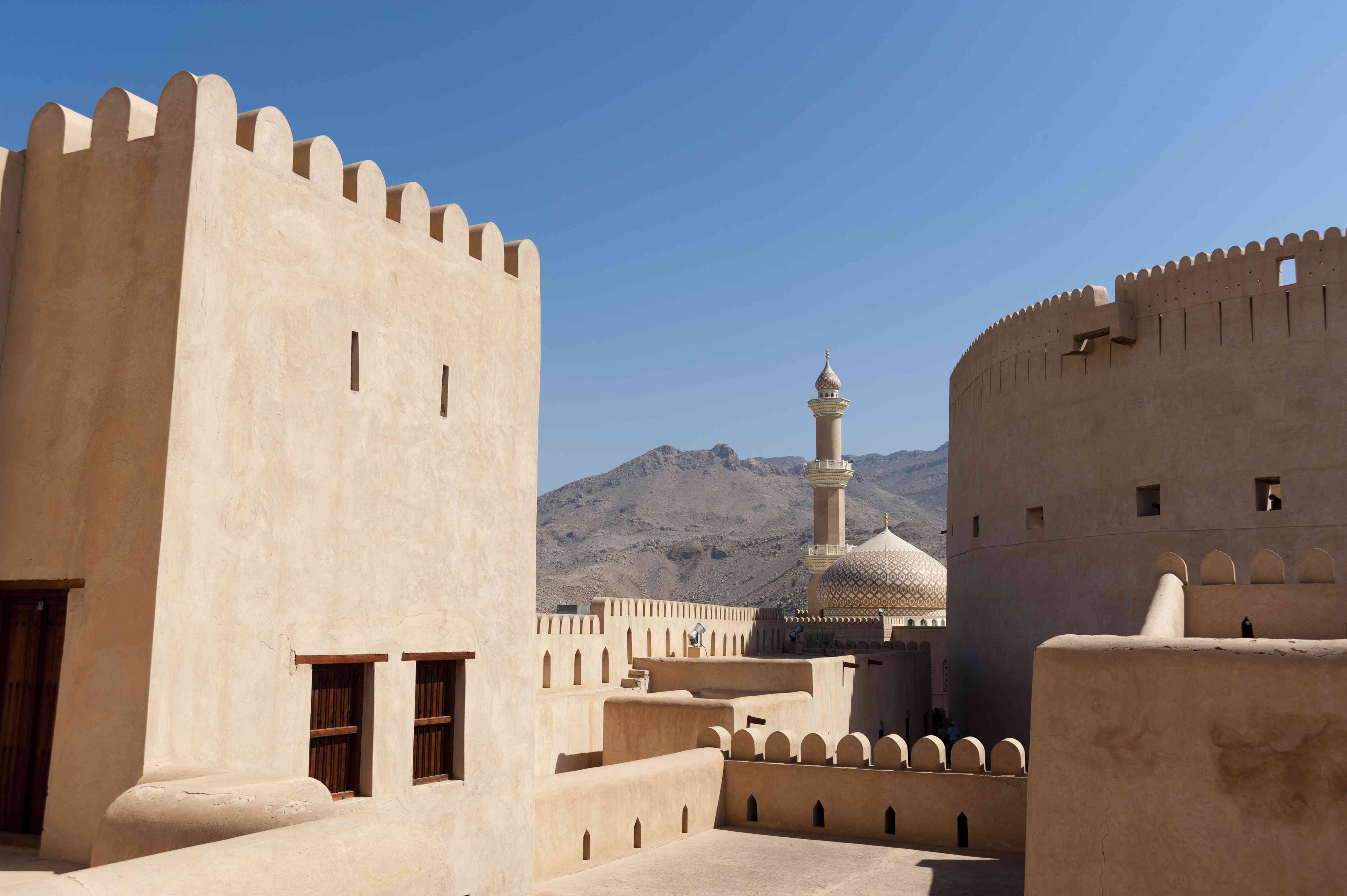 Light-colored stone ramparts at Nizwa fort, Oman