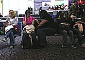 Travelers Seated in Terminal at Heathrow Airport