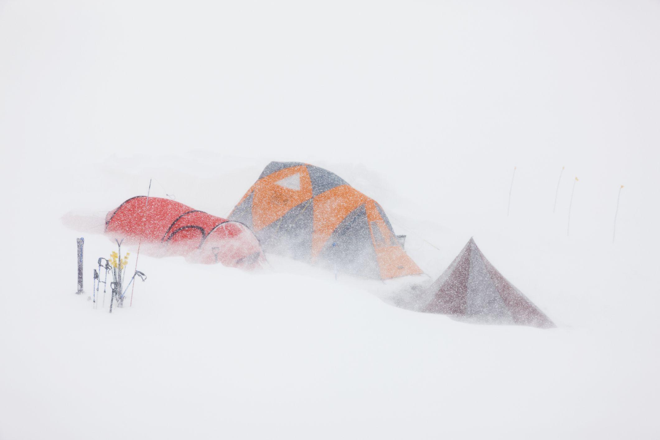 Base camp on the Ruth glacier, Alaska range, during snowstorm, interior, Alaska.