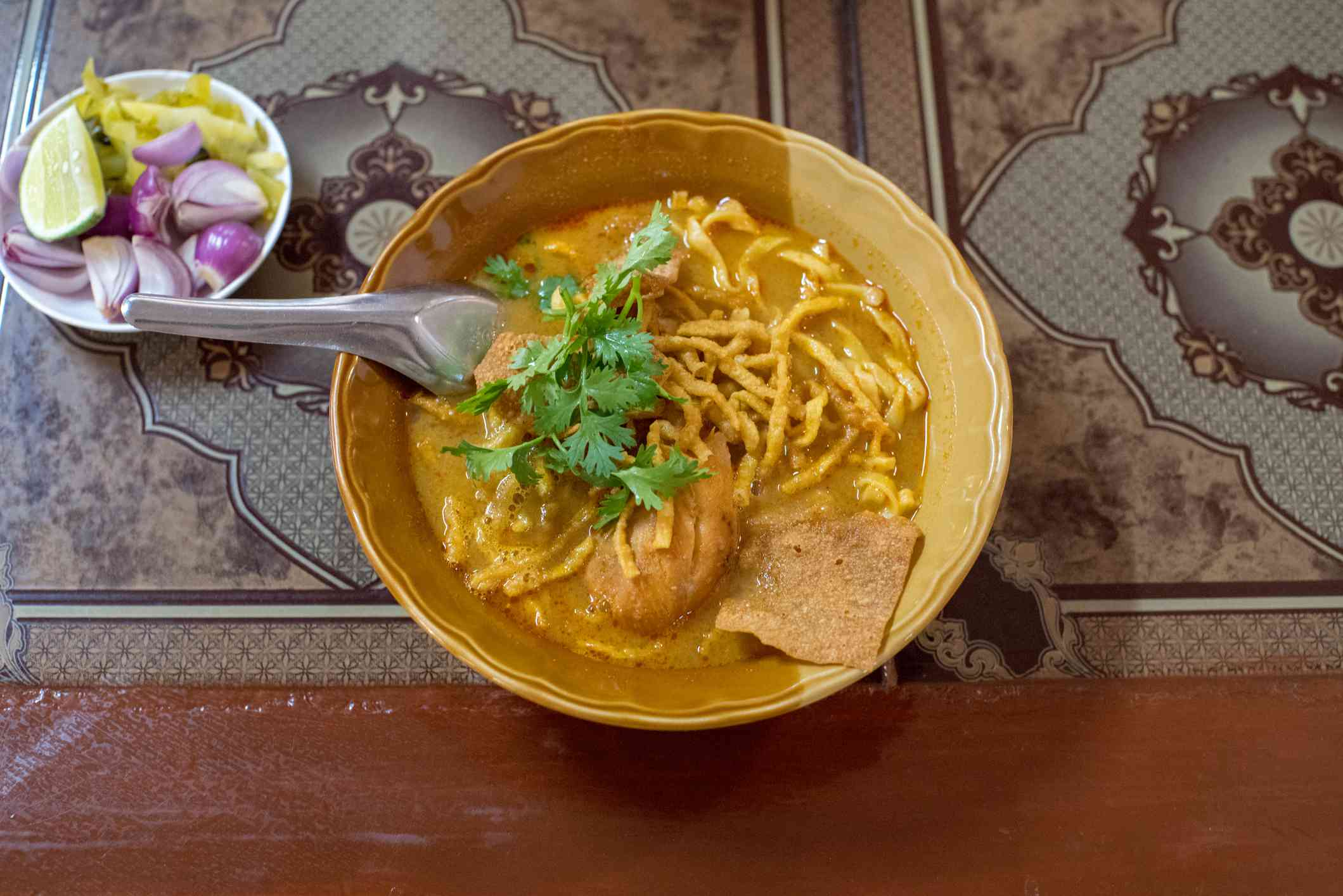 overhead view of a bowl of khao soi
