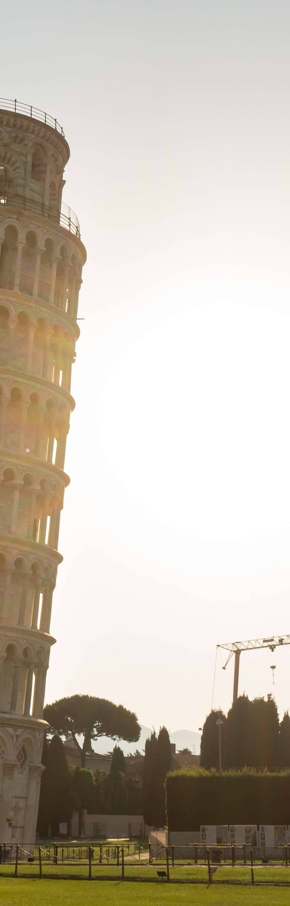 The Leaning Tower of Pisa with the sun setting behind it
