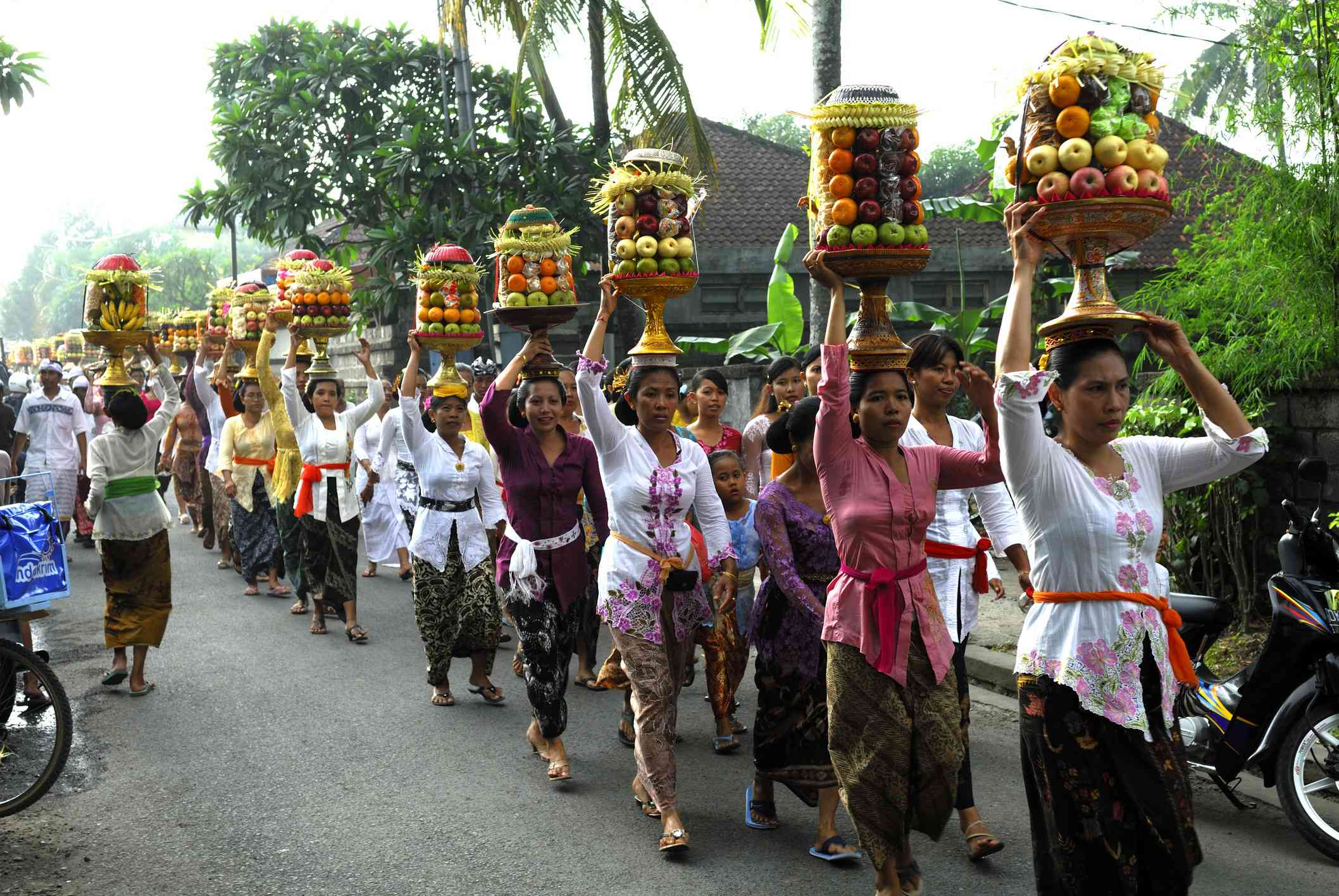 Women carrying offerings to the village temple as part of the celebration of Galungan