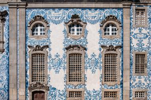 Porto Portugal, Igreja do Carmo Connected to its twin church by a house, this baroque church has a well-known tiled side facade. Porto Portugal