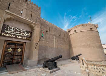 Entrance to Al Fahidi fort with cannons in front