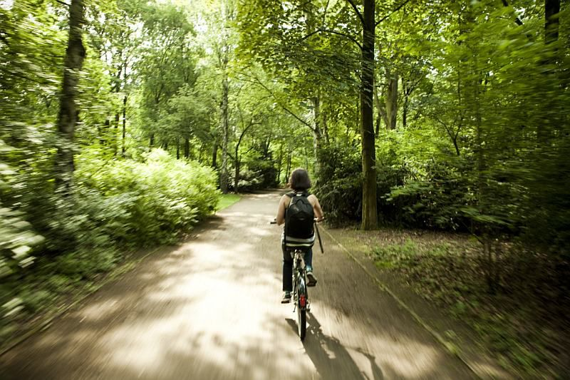 Woman biking down a trail