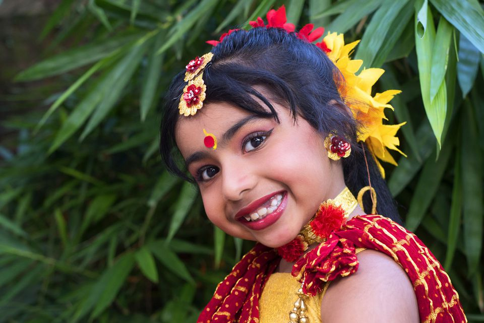 A picture of a girl in southeast Asian traditional dress