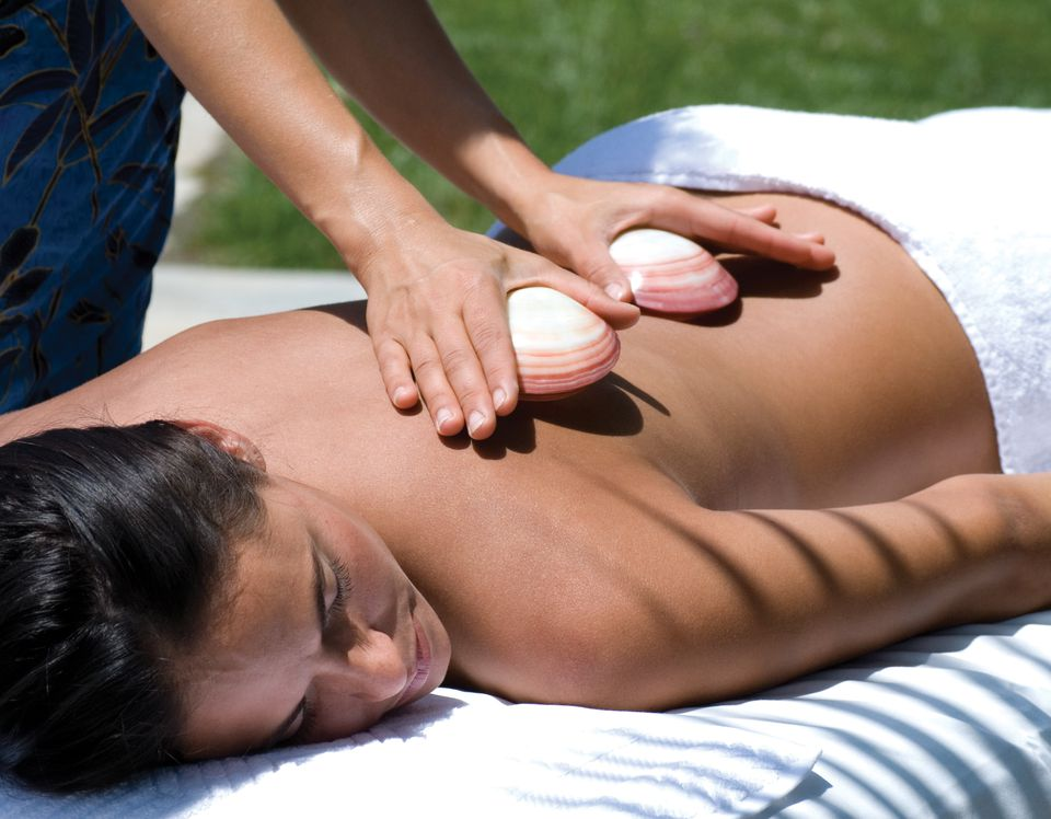 Woman getting lava shell massage