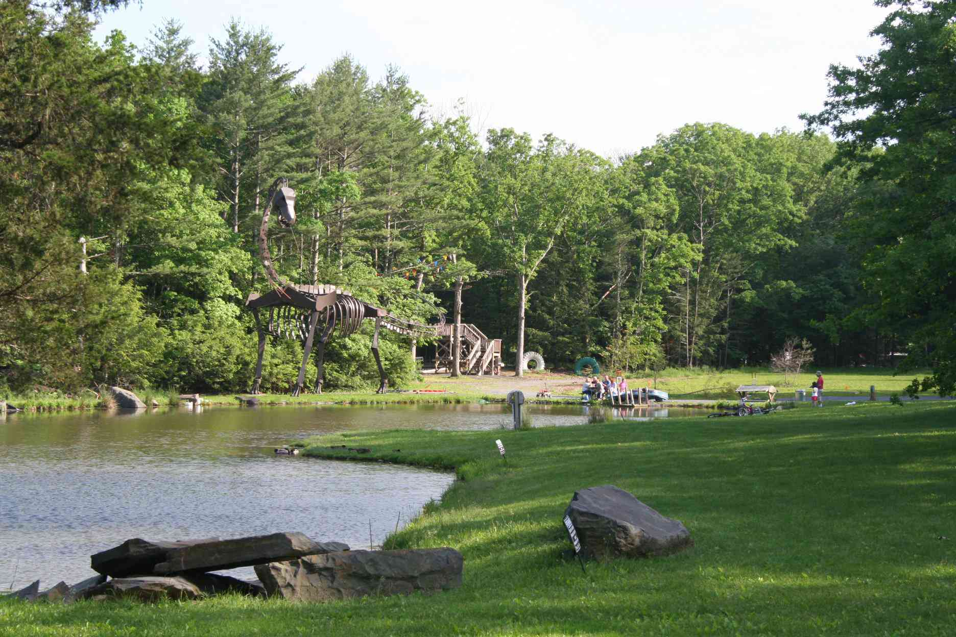 Pond and large statue at Rip Van Winkle Campgrounds