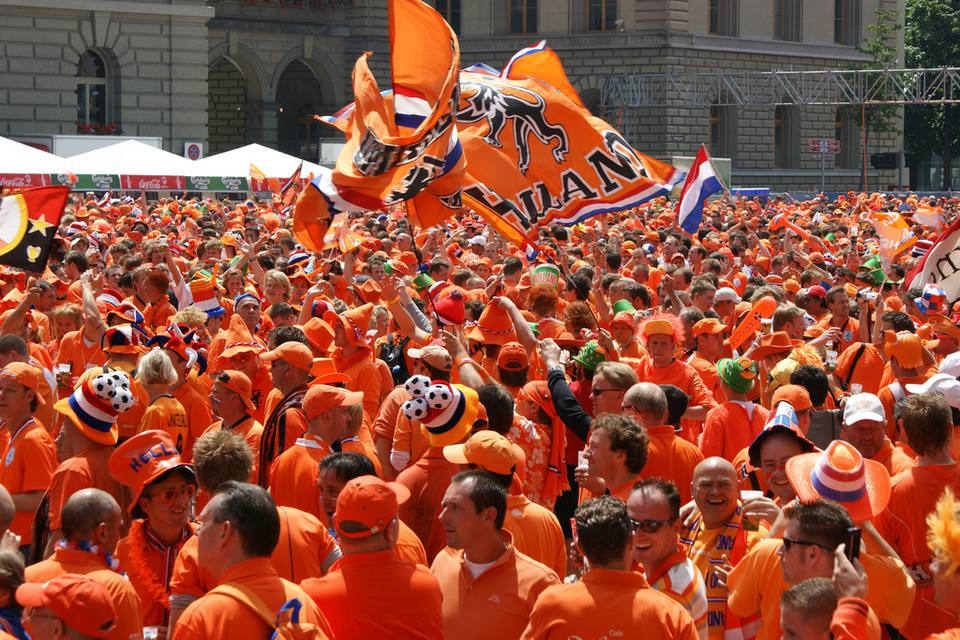 Dutch gathering wearing orange clothing