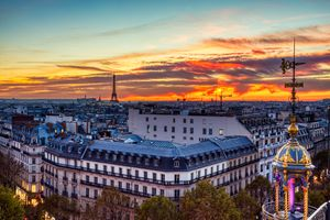 Aerial view of Illuminated Paris at Dusk with Eiffel Tower