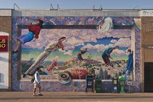 'Le Bonheur de vivre' (The Joy of Life) mural by Doug Jacques at W 24th Street near UT campus.
