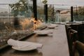 plates and napkins on a stone bar with a fire place behind it
