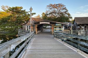 Wooden bridge and Welcome to Smithville Sign
