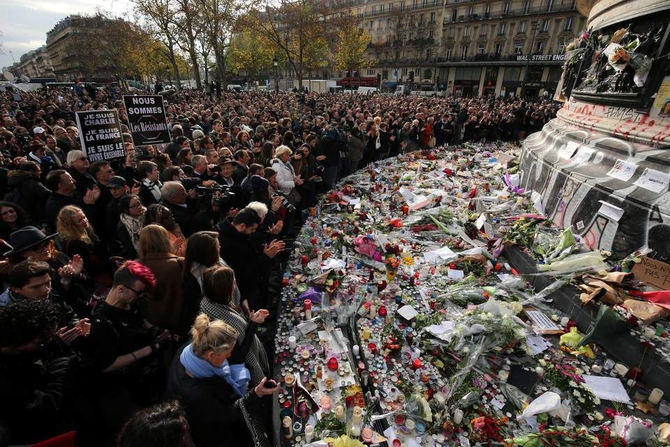People observe a minute-silence at the Place de la Republique in memory of the victims of the Paris terror attacks last Friday, on November 16, 2015 in Paris, France.
