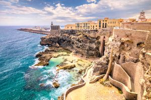 City walls, lighthouse and harbor in Melilla.