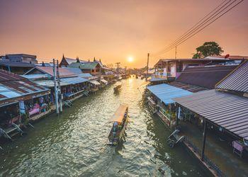 Boat floating along Amphawa riverside market, Bangkok, Thailand.