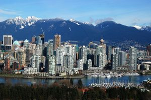 Vancouver with False Creek in foreground and Grouse Mountain and the North Shore Mountains in background.