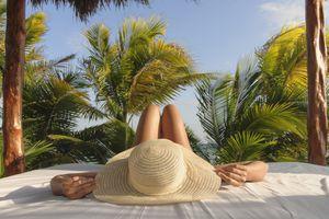 Woman laying down in sun hat