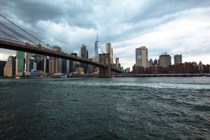The Brooklyn Bridge stretching towards Manhattan