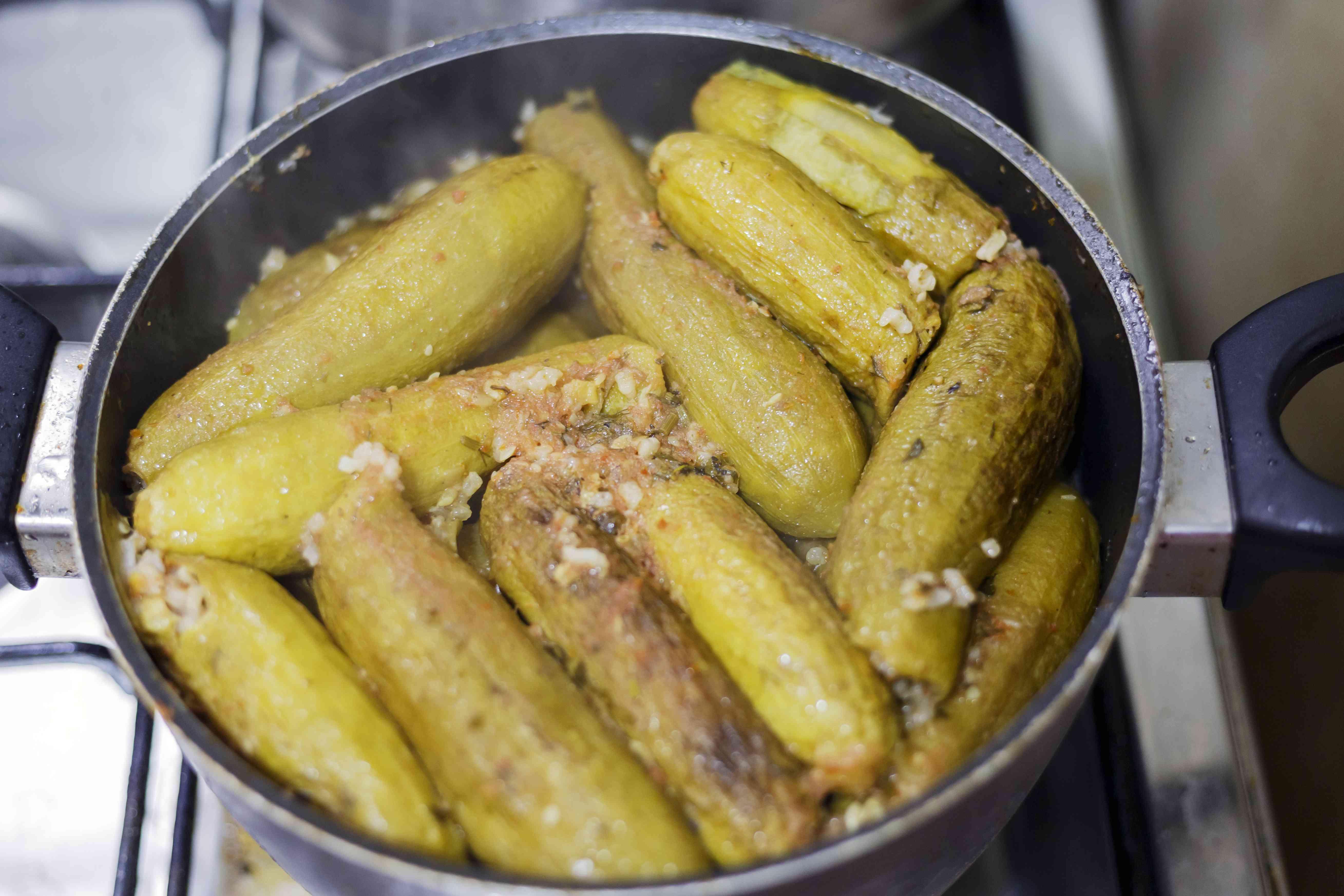 Stuffed zucchini (kousa mahshi) in cookware.